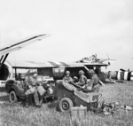 Men of Headquarters Artillery Group of UK 1st Airlanding Reconnaissance Squadron landing near Arnhem, Gelderland, the Netherlands, 17 Sep 1944; note the two collided Horsa gliders in background