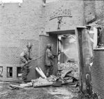 Sergeant J. Whawell and Sergeant J. Turl of the UK Glider Pilot Regiment searching a damaged ULO school for German snipers, Kneppelhoutweg, Oosterbeek, Gelderland, the Netherlands, 21 Sep 1944