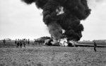 An American C-47 aircraft, hit by flak returning from the Market-Garden drop, burning after crash-landing into a knocked-out German Jagdpanther near Gheel, Belgium, 17 Sep 1944