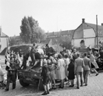 Vehicles and men of the Guards Armoured Division of the British XXX Corps passing through Grave, southern Netherlands, 19 Sep 1944
