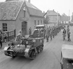 Men of 158 Brigade, UK 53rd (Welsh) Division escorting German prisoners, the Netherlands, 19 Sep 1944; note Universal Carrier leading the column
