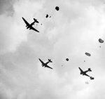 C-47 Dakota aircraft dropping troops of UK 1st Airborne Division over Oosterbeek near Arnhem, the Netherlands, 17 Sep 1944