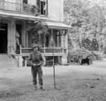 Major General Robert E. Urquhart of UK 1st Airborne Division planting the airborne flag outside his headquarters near Arnhem, the Netherlands, 22 Sep 1944