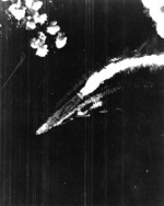 Hiryu maneuvering to avoid three sticks of bombs dropped by B-17 bombers, off Midway Atoll, shortly after 0800 hours, 4 Jun 1942, photo 2 of 2