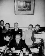 Molotov signing the German-Soviet non-aggression pact, Moscow, Russia, 23 Aug 1939; Shaposhnikov, Ribbentrop, and Stalin in back row
