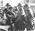 Japanese soldiers purchasing items from Chinese vendors, Nanjing, China, 17 Dec 1937; the Chinese claimed this to be a staged photo for propaganda