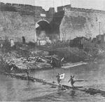 Japanese soldiers crossing a river near the Nanjing city wall, China, 13 Dec 1937