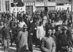Chinese men being registered by newly arrived Japanese occupation, possibly Nanjing, China, late 1937 or early 1938