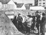Japanese troops ordering Chinese civilians out of an air raid shelter, Nanjing, China, 14 Dec 1937