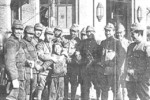 Japanese soldiers with a Chinese child, Nanjing, China, 19 Dec 1937
