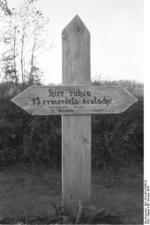 Grave marker for 13 German civilians killed by Soviets, Nemmersdorf, East Prussia, Germany, late Oct 1944, photo 2 of 2