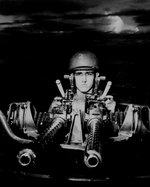 A PT boat gunner at his 50-cal machine gun, New Guinea, Jul 1943