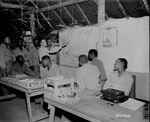 African-American soldiers of the US Army 477th Antiaircraft Artillery, Air Warning Battalion studying maps, Oro Bay, New Guinea, 15 Nov 1944