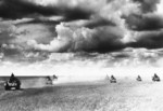 Type 89 tanks advancing across a grassy field, Mongolia Area, China, 1939