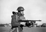 A lance corporal of the British Army East Surrey Regiment posed with a Thompson sub-machinegun, Chatham in Kent, England, United Kingdom, 25 Nov 1940