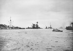 A Gooseberry line of block ships off the Normandy beaches, Ouistreham, France, Jun 1944; note sunken British ship Durban, sunken Dutch ship Sumatra, and two active DUKW craft