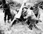 American 105mm Howitzer M3 shelling German forces near Carentan, France, 11 Jul 1944