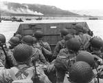 American troops watched activity ashore on Omaha Beach as their LCVP landing craft approached the shore, Normandy, 6 Jun 1944, photo 1 of 2