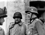Major General Manton Eddy and another American officer speaking to a captured German officer, Cherbourg, France, 26-27 Jun 1944