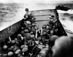 American troops en route to the invasion beach aboard LCVP landing craft, Normandy, France, 6 Jun 1944