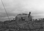 Damaged German defensive fortification at Bernières-sur-Mer, France, Jun 1944