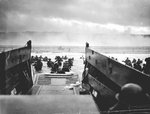 A LCVP from the U.S. Coast Guard-manned USS Samuel Chase disembarked troops on a Normandy beach, 6 Jun 1944