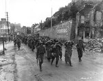 US Army troops marched German prisoners of war through Cherbourg, 28 Jun 1944