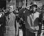 An US Army colonel and a French civilian in Cherbourg during the playing of the American national anthem, 28 Jun 1944