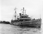 ATO Owl entered Cherbourg harbor, France, towing two barges loaded with engineer equipment, 18 Jul 1944; she was the first ship carrying supplies to enter Cherbourg harbor after Allied victory