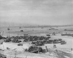 Allied cargo transfer point on Omaha Beach, 19 Jul 1944; note British battleship Centurion in the center of background