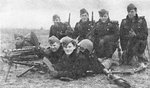 Danish machine gun team gathered for a photo hours before engaging with German invaders, Bredevad, Denmark, 9 Apr 1940; two of the men died later that day; note Madsen light machine gun