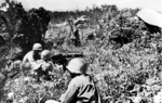 Browning M1917A1 machine gun crew of US 96th Division on the top of Yaeju-Dake Hill, Okinawa, Japan, 18 Jun 1945; note yellow cloth front lines marker on right