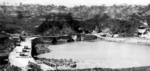 Machinato Inlet immediately after combat, Okinawa, Japan, 19 Apr 1945; note wrecked M29 Weasel vehicles on the road