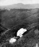 US Marine F4U Corsair fighter dropping a fire bomb on a Japanese position in Northern Okinawa, Japan, circa Apr-Jun 1945