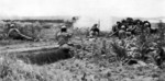 Men of the 383nd Infantry Regiment, US 96th Division firing at a Japanese position in the Mashiki area, Okinawa, Japan, circa Apr 1945
