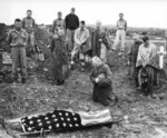 US Marine Colonel Francis Fenton conducting the funeral of his son Private First Class Mike Fenton, near Shuri, Okinawa, Japan, May 1945