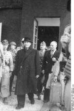 Former Italian Prime Minister Benito Mussolini and Inspector General Giuseppe Gueli being escorted out of Hotel Campo Imperatore, Gran Sasso, Italy, 12 Sep 1943, photo 2 of 2
