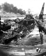 Wrecks of destroyers Downes and Cassin in Drydock One at Pearl Harbor Navy Yard, 7 Dec 1941 about 1400, photo 1 of 5; note Pennsylvania in the rear, Helena in distance, Oklahoma and Maryland in far background