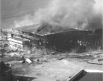 Seaplane hanger ablaze after being bombed by Japanese aircraft, Ford Island, Pearl Harbor, US Territory of Hawaii, 7 Dec 1941, photo 1 of 2