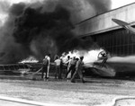 PBY patrol bomber burning at Naval Air Station Kaneohe, Oahu, during Pearl Harbor attack