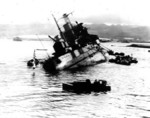 USS Utah capsizing early in the attack on Pearl Harbor, Dec 7, 1941.  Photo taken from USS Tangier.