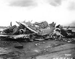 Destroyed US Army aircraft at Wheeler Field, Oahu, during post-Pearl Harbor raid clean up, Dec 1941; note P-40 parts in the pile