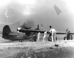 Men attempting to save a burning PBY Catalina aircraft, Naval Air Station Kaneohe, Oahu, US Territory of Hawaii, 7 Dec 1941