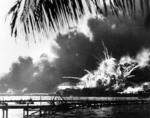 Photo capturing the moment the powder magazine of the USS Shaw exploded during the Pearl Harbor Attack, 7 Dec 1941 at about 0930. Note the after turrets of the USS Nevada passing in the channel at right.
