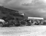 Damaged cars and hangar building at Naval Air Station Kaneohe, Oahu, US Territory of Hawaii, 7 Dec 1941