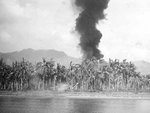 A column of smoke rising from beachhead on Leyte, Philippine Islands from American naval shelling, 20 Oct 1944