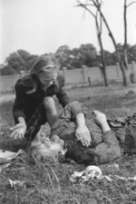 Ten-year-old Polish girl Kazimiera Mika mourning the death of her sister, caused by strafing German aircraft, near Jana Ostroroga Street, Warsaw, Poland, 13 Sep 1939, photo 1 of 3