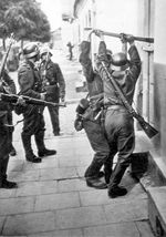 German troops forcing entry into a building, Western Poland, Sep 1939