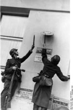 German troops removing the Polish emblem from the wall of a post office in Danzig, 1 Sep 1939