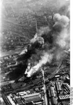 The grain silo at the intersection of Bema and Pradzynskiego Streets burning, Warsaw, Poland, Sep 1939